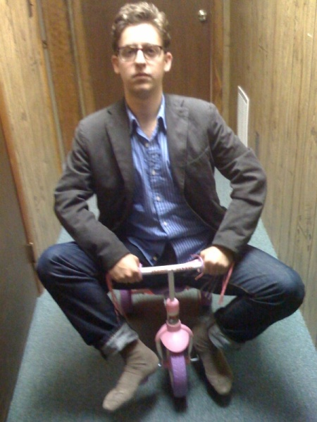serious kiddie tricycle riding